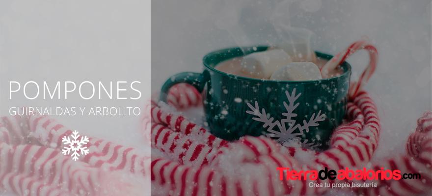 Aprende cómo hacer unas guirnaldas y un arbolito de navidad con pompones